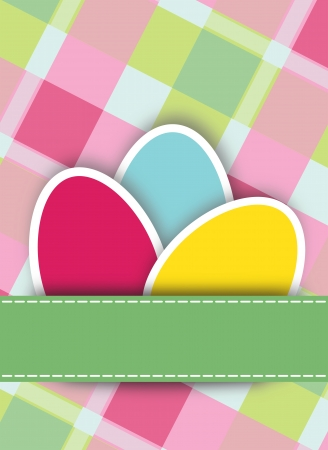 Colourful vivid cut out card Easter Eggs arranged with a blank green ribbon or banner for your greeting over a fresh checkered country background