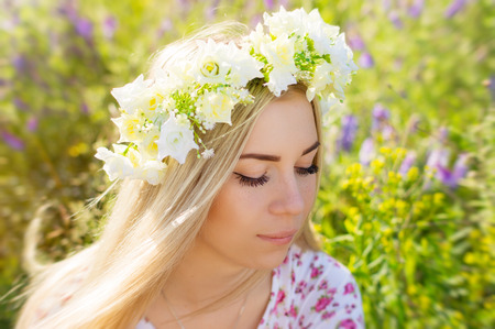coronet: Young female with blond hair and flower coronet Stock Photo