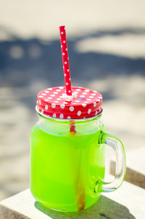 neon green: Glass with fresh juice of neon green color Stock Photo