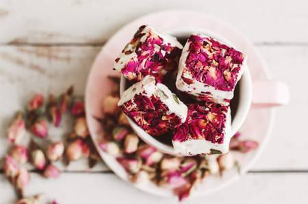 Lebanese sweets with edible flower petals. Nougat. Turkish delight with hibiscus