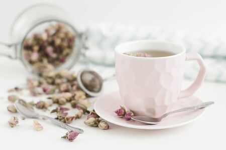 Pink cup with rose tea. Herbal drink