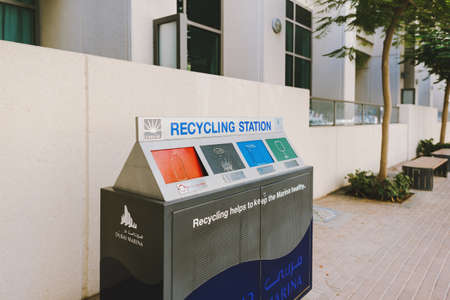 Dubai; UAE - June 6, 2020: Recycling station at Dubai Marina residential area for garbage and wastes to sort and recycle plastic, paper, metal