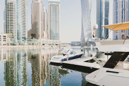 Dubai; UAE - June 6, 2020: Yachts and boats at Dubai Marina, a popular tourist attraction and residential area with artificial water canal Editöryel