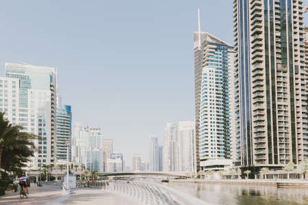 Dubai; UAE - June 6, 2020: Dubai Marina Promenade with artificial water canal, residential buildings, hotels, offices and restaurants Editöryel