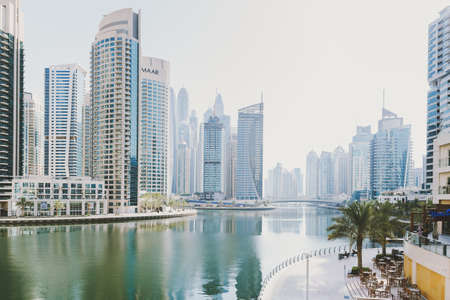 Dubai; UAE - June 6, 2020: Dubai Marina cityscape, view from the bridge over artificial water canal Editöryel