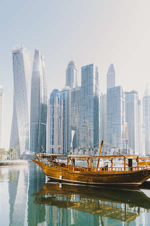 Dubai; UAE - June 6, 2020: Old traditional Arabic Dhow boat renovated in floating restaurant for water tours across Dubai Marina