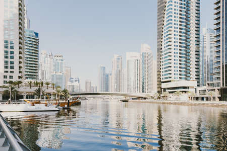 Dubai; UAE - June 6, 2020: Artificial water canal along Dubai Marina promenade early in the morning