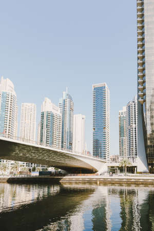 Dubai; UAE - June 6, 2020: Bridge over artificial water canal connecting two sides of Dubai Marina residential area Editöryel
