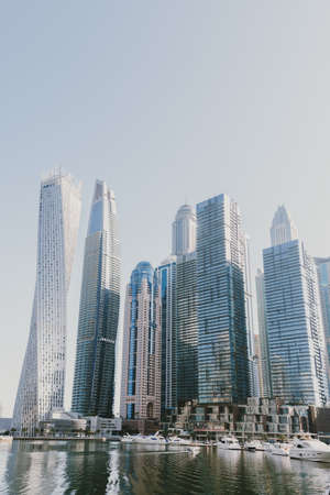 Dubai; UAE - June 6, 2020: Skyscrapers, hotels, offices and residential buildings at Dubai Marina, a popular torist destination with artificial water canal