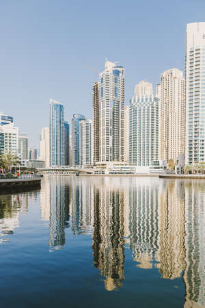 Dubai; UAE - June 6, 2020: Artificial water canal at Dubai Marina. View at Jumeirah Beach Residence buildings