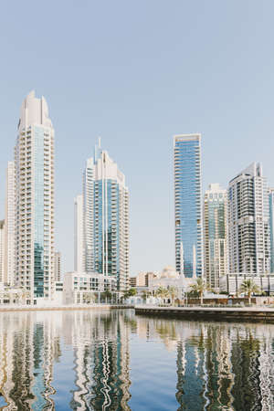 Dubai; UAE - June 6, 2020: View over Dubai Marina through artificial water canal. Residential and office buildings, hotels and mosque Editöryel