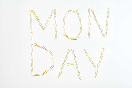 Word 'Monday' made from metal paper clips on white background. Office work concept 版權商用圖片
