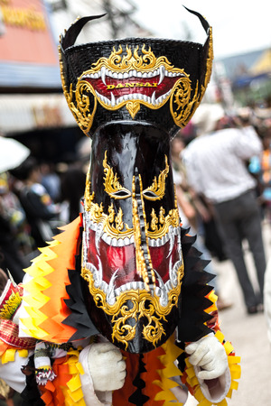 joyfully: Phi Ta Khon Festival on June  in Moung Loei of Thailand. The people dress in spirit and wear a mask, sing and dance joyfully.