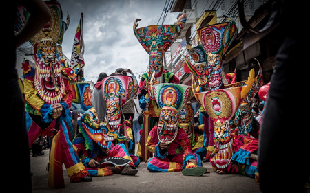 joyfully: LOEI, THAILAND - JUNE: Phi Ta Khon Festival on June  in Moung Loei of Thailand. The people dress in spirit and wear a mask, sing and dance joyfully.
