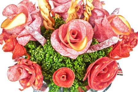 arranged bouquet of salami , sausages and cheeses  photo