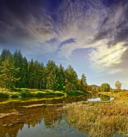 秋の川の上夕日 写真素材