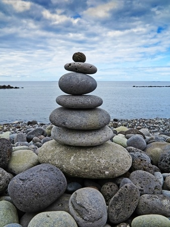 stack of stones on the beach and sea background photo