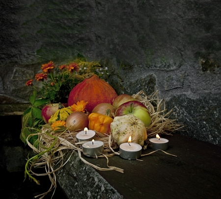 halloween still life with pumpkins and candles in the night time photo