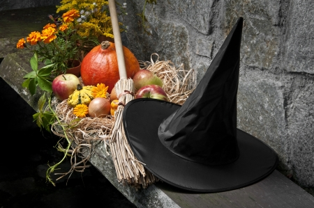 halloween still life with pumpkins and witch hat and broom photo
