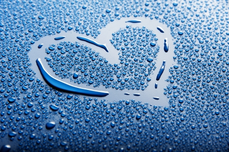a heart shape between blue water drops