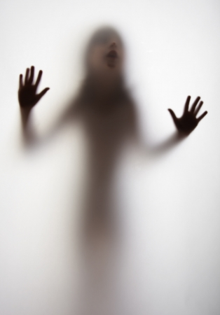 nightmare: a girl silhouette behind a  transparent  paper background Stock Photo