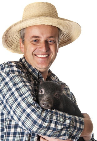 a happy farmer with a little black pig Stock Photo - 17135380