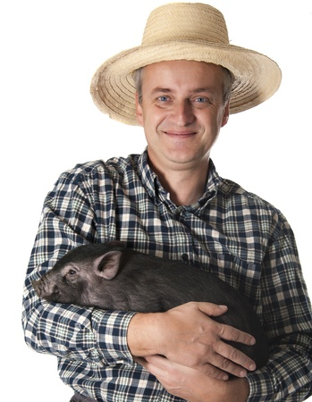 a happy farmer with a little black pig - white background Stock Photo - 17135378