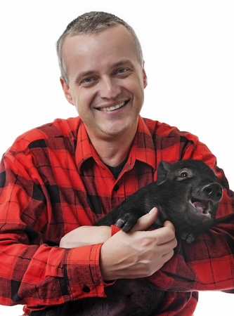 a happy farmer with a little piglet Stock Photo - 17135379