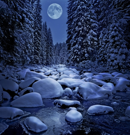 snowy mountain: winter night and snow covered river Stock Photo