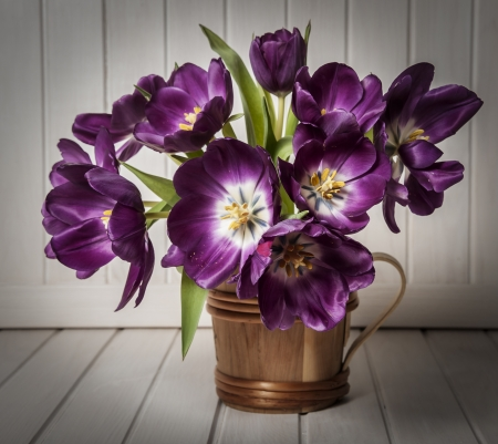 antique vase: purple tulips in vase - vintage style Stock Photo