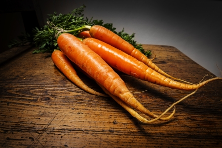 carrots on an old wooden background photo