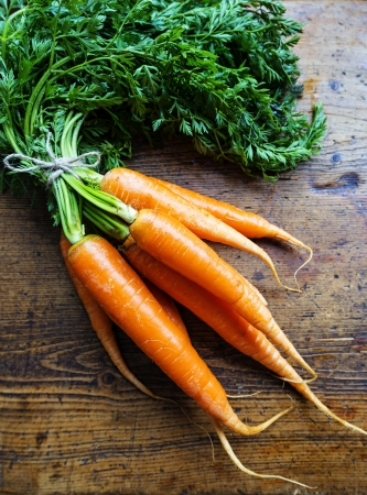 carrots on a wooden background photo