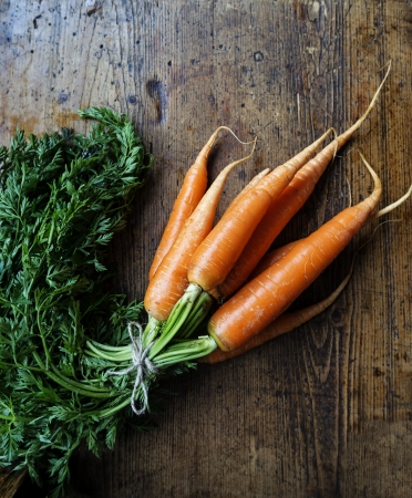 carrots on wooden background photo