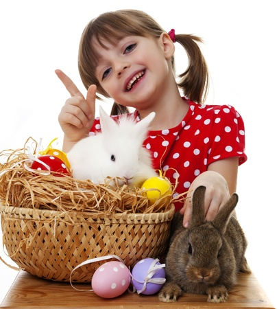 happy little girl with easter rabbits and eggs photo