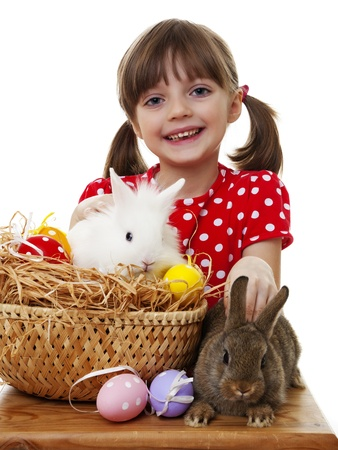 happy little girl with easter rabbits and easter eggs photo