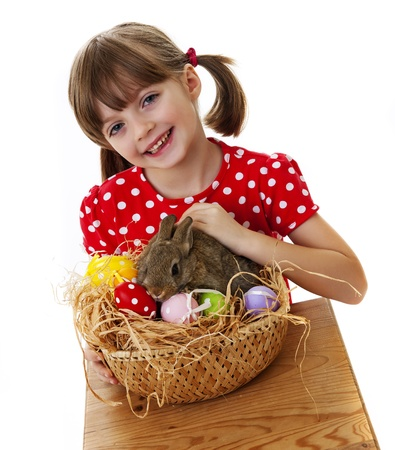 happy little girl with easter rabbit and easter eggs isolated photo