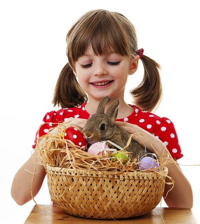 happy little girl with easter rabbit isolated photo