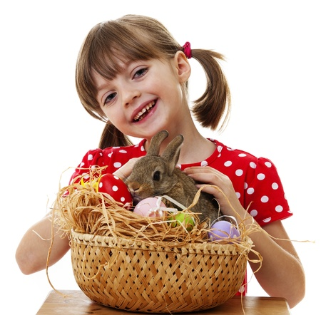 happy little girl with easter rabbit isolated on white photo