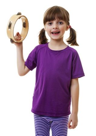 pandero: niña jugando y cantando - pandereta Foto de archivo