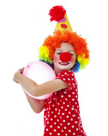a happy little clown on white background photo