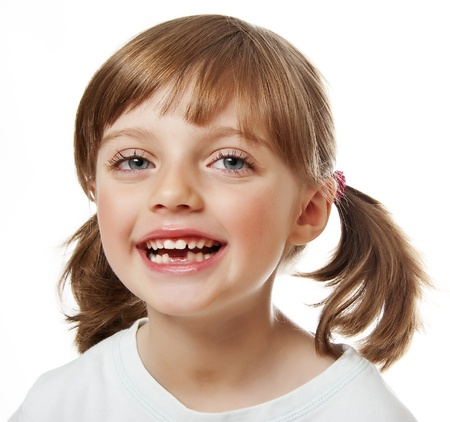 toothless: baby tooth  - little girl with missing teeth   Stock Photo