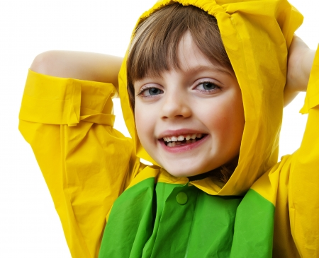 happy little girl with raincoat isolated on white photo