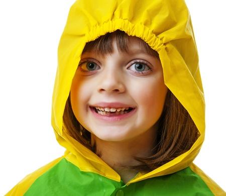 rain coat: little girl with raincoat isolated  Stock Photo