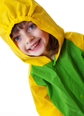 little girl with raincoat isolated on white photo