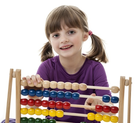 happy little girl counting with abacus - white background photo