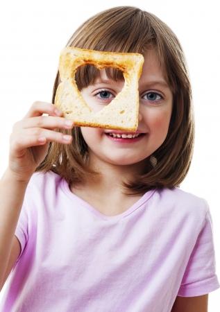 little girl holding  bread - white background Stock Photo - 18266408