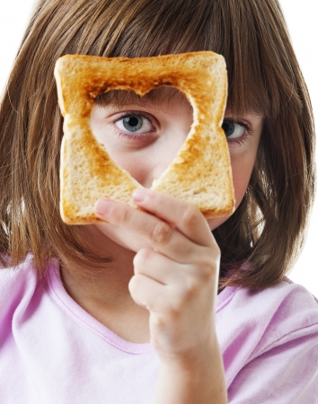 little girl with slice of bread photo