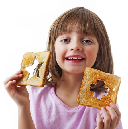little girl with bread white background Stock Photo - 18279333