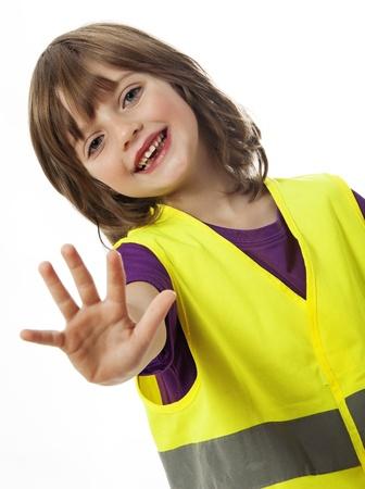 stop - niña con chaleco de alta visibilidad