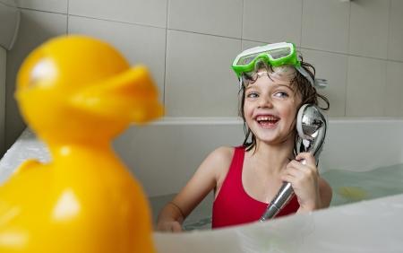 bathe:  happy little girl have a bath